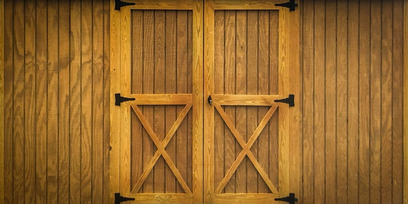 A wooden door on a custom shed in Kentucky