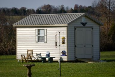 A shed in Kentucky with vinyl siding and double doors