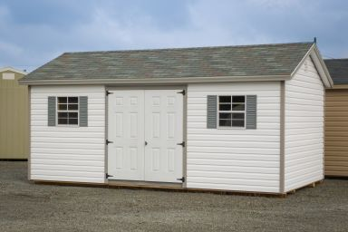 A shed in Kentucky with vinyl siding and vinyl double doors