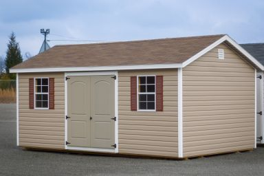 A shed in Kentucky with vinyl siding, windows, and a shingle roof