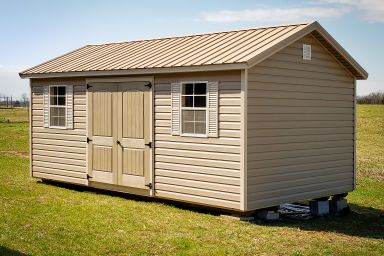 A shed in Kentucky with vinyl siding and a metal roof