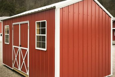 A metal shed in Kentucky with double doors and windows