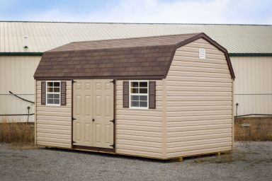 A lofted vinyl shed in Kentucky with double doors, windows, and shutters