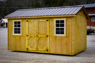 A wooden shed in Tennessee with double doorsand windows