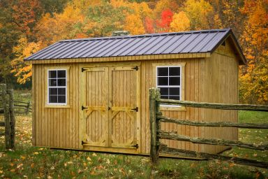 A shed in Tennessee with wooden siding and a metal roof