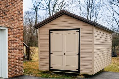 A delivered shed in Tennessee with vinyl siding and double doors