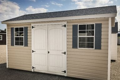 A garden shed in Kentucky with vinyl siding and a shingle roof