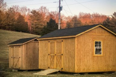 Garden sheds in Tennessee with wooden siding and double doors