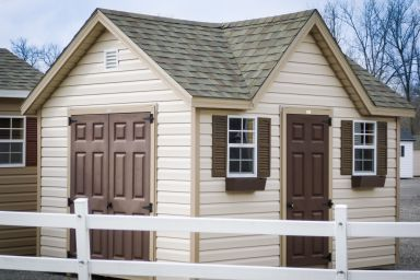 A storage shed in Kentucky with a roof dormer and double doors