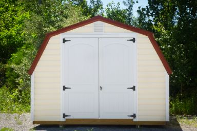A backyard shed in Kentucky with vinyl siding, and red metal roof, and double doors