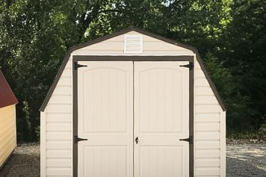 A backyard shed in Tennessee with vinyl siding