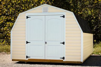 A portable shed in Kentucky with vinyl siding, a shingle roof, and double doors