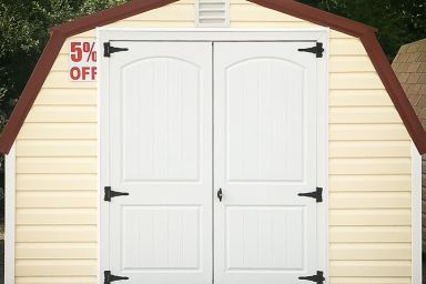 A discounted portable shed in Tennessee with yellow vinyl siding, a metal roof, and double doors