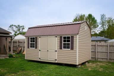 A lofted outdoor shed in Kentucky with vinyl siding and a metal roof