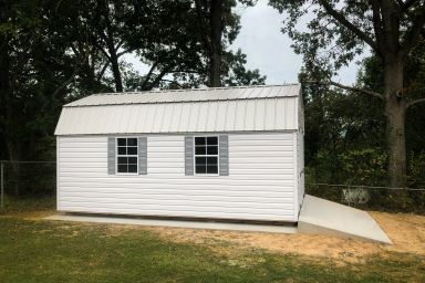 An outdoor shed with a loft in Kentucky with vinyl siding and concrete foundation