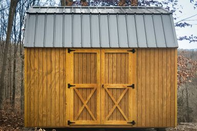An outdoor shed with a loft in Kentucky with wood siding and a metal roof