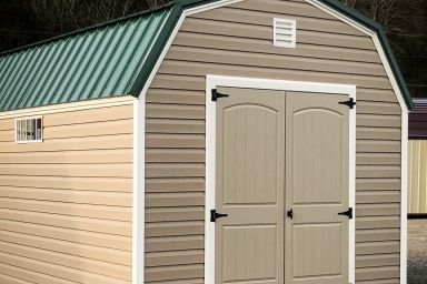 An outdoor shed in Kentucky with vinyl siding, double doors, and a green metal roof