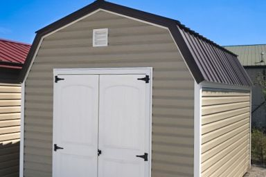 An outdoor shed in Tennessee with vinyl siding, double doors, and a metal roof