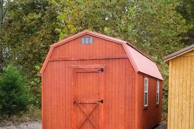 An outdoor shed with a loft in Tennessee with wood siding