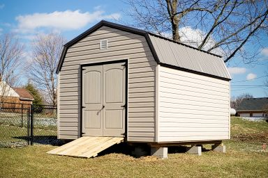 A vinyl outdoor shed in Tennessee double doors and a metal roof