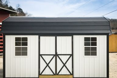 An outdoor shed in Tennessee with metal siding, double doors, and a metal roof