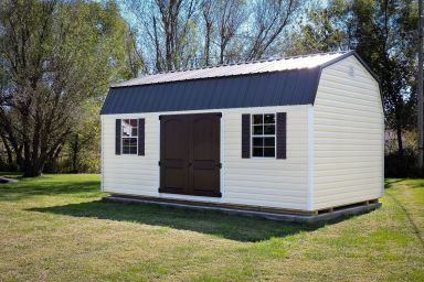 A portable storage building in Kentucky with vinyl siding and double doors