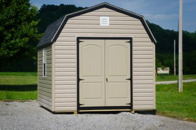 A storage building in Kentucky with vinyl siding and a loft