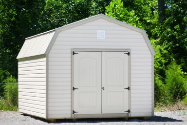 A storage building in Tennessee with vinyl siding and a loft