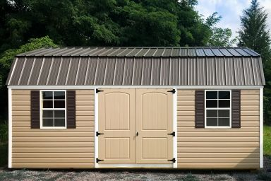 A storage building in Tennessee with brown vinyl siding and double doors