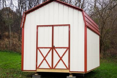 A prefab storage building in Tennessee with metal siding and a red metal roof
