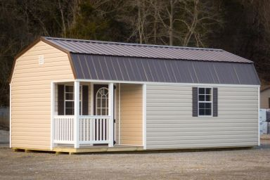 A small cabin for sale in Kentucky with vinyl siding and a loft