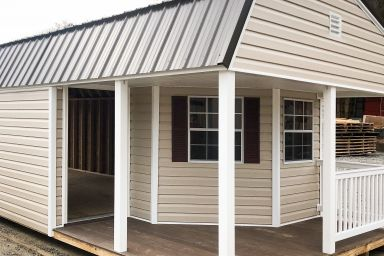 A small cabin for sale in Tennessee with vinyl siding and a porch