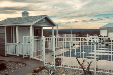 A portable cabin poolhouse for sale in Kentucky with a porch