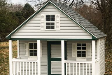 A portable play cabin for sale in Tennessee with vinyl siding