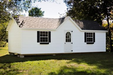 A portable cabin in Kentucky with vinyl siding and a roof dormer
