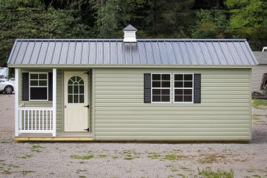 A portable cabin in Tennessee with a corner porch and a metal roof