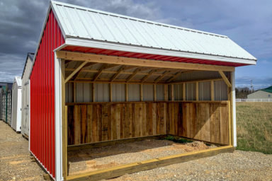 A red metal horse run-in shed sold in Kentucky