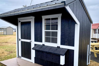 A black and white prefab pet shed for sale in Kentucky