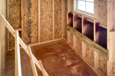 Interior of a prefab pet shed for sale in Tennessee for chickens