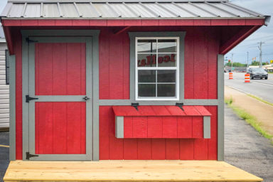 A red custom chicken coop for sale in Kentucky