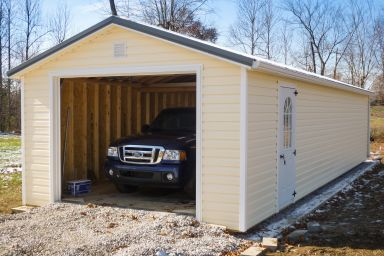 A portable garage in Kentucky with vinyl siding and a metal roof