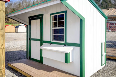 A chicken coop for sale in Tennessee with a porch