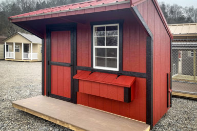 A small chicken house for sale in Kentucky with wooden siding