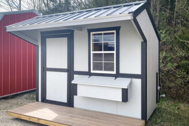 A white and black backyard chicken house for sale in Tennessee