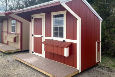 A red backyard chicken house for sale in Tennessee with a porch