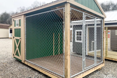 A green and brown outdoor dog kennel for sale in Kentucky