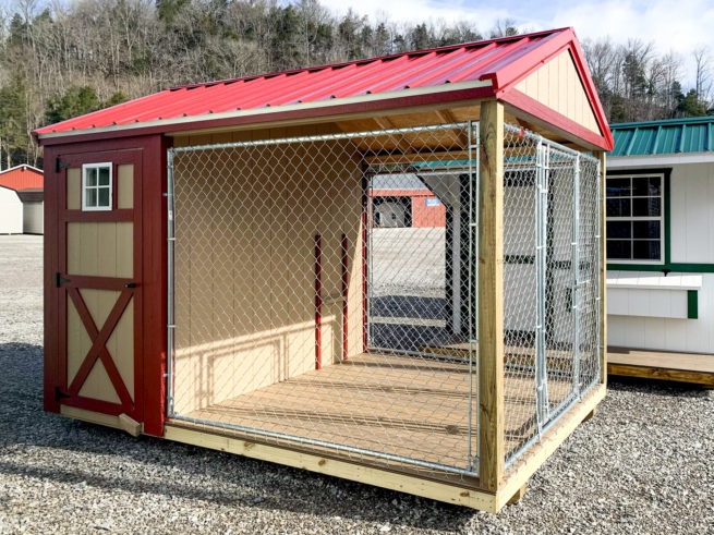 A prefab dog kennel for sale in Tennessee with a red metal roof