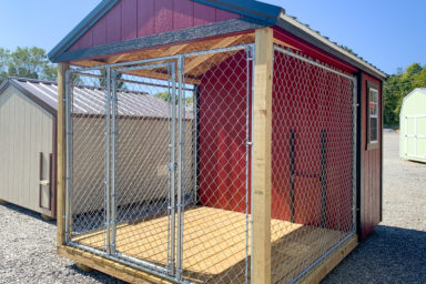 A red prefab dog kennel for sale in Tennessee