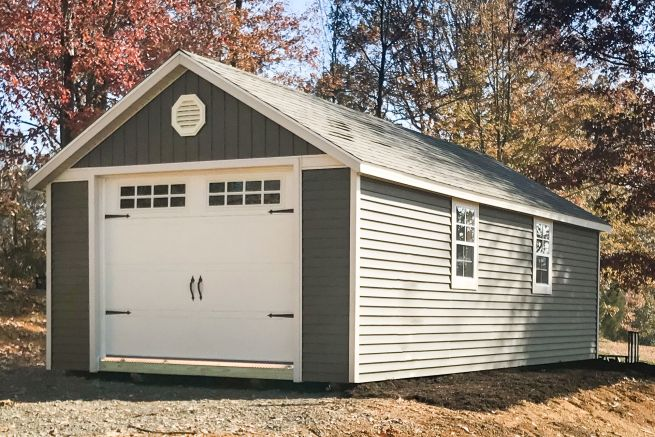 A portable garage in Tennessee with vinyl siding and a roof vent