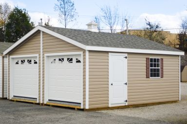 A multiple-car prebuilt garage in Kentucky with vinyl siding